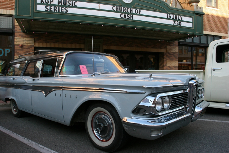 A 1959 Edsel Village Wagon is parked in front of the Paradise Center for the Arts with its restored marquee.