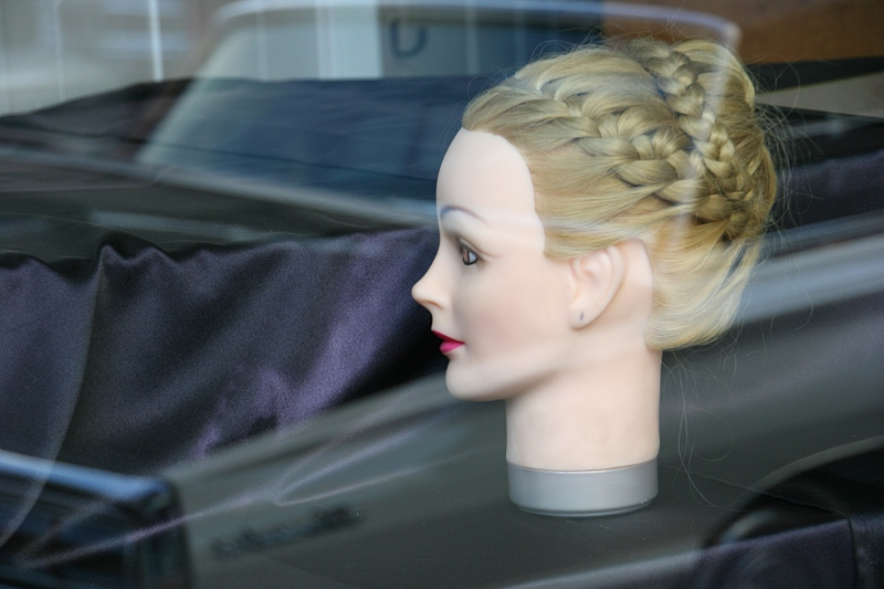 While photographing vehicles, I noticed the truck reflection in the storefront window of a hair salon.