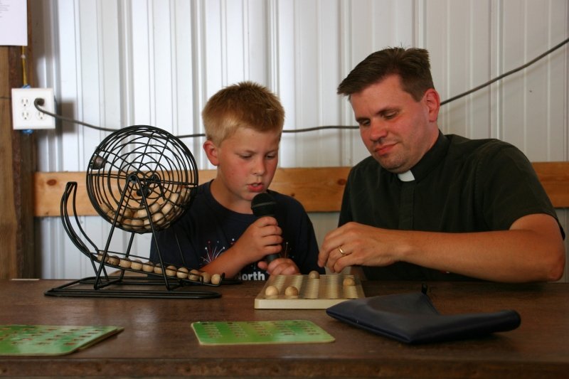 The Rev. Juan Palma of Trinity Lutheran Church North Morristown teams up with his son to call bingo.