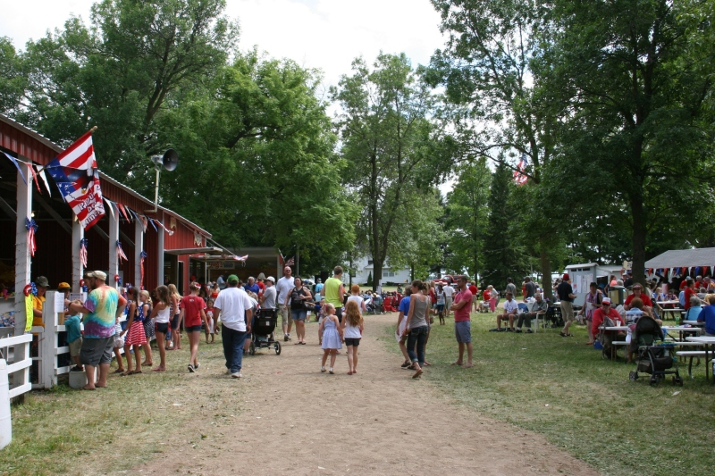 Kids' activities are to the left, food and beverage stands to the right and the entertainment stage straight ahead.
