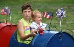 Fourth of July, 19 boy & girl riding intrain