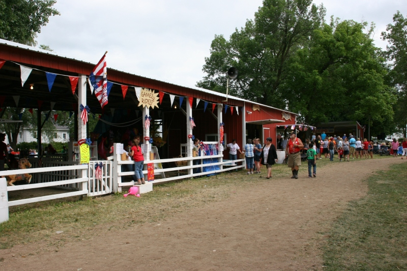 Games, rides and the ticket booth are housed in this red poleshed.