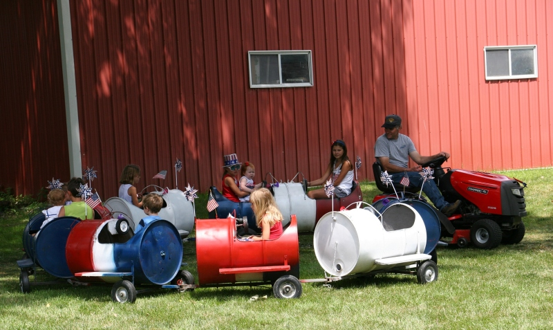 The old-fashioned barrel train draws lots of riders.