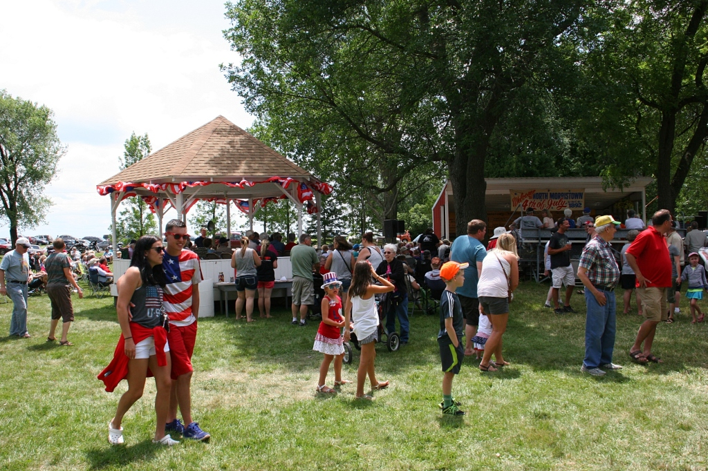 Red, white and blue attired prevailed among fest-goers who settled in a gazebo, on lawn chairs and grass and on bleachers to hear musicians perform.