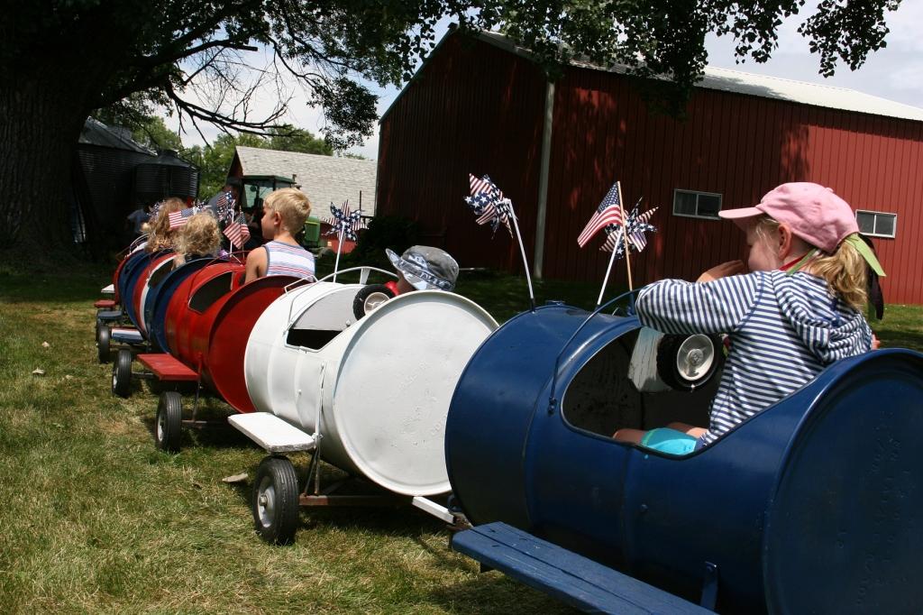 The barrel train chugs away across the lawn.