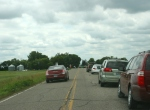 Fourth of July, 4 cars along road to N.Morristown