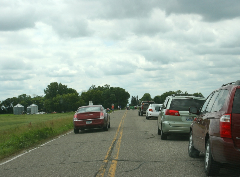 Vehicles lined county roads leading to the festival grounds and also filled parking areas.