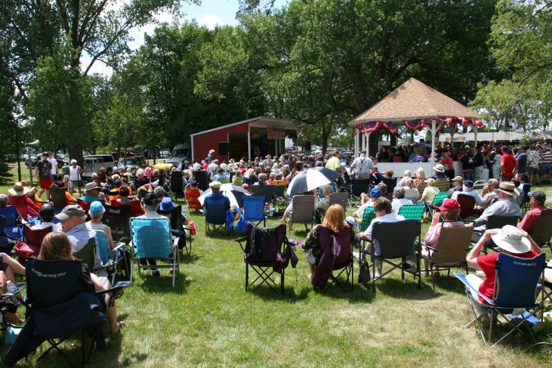 An appreciative crowd listens to Monroe Crossing, a popular bluegrass band.