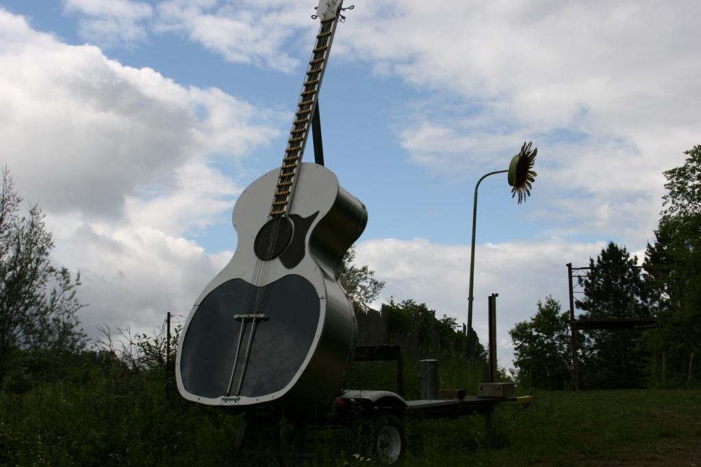 This guitar sculpture and other sculptures are perched atop a hill along Interstate 35 south of Lakeville.