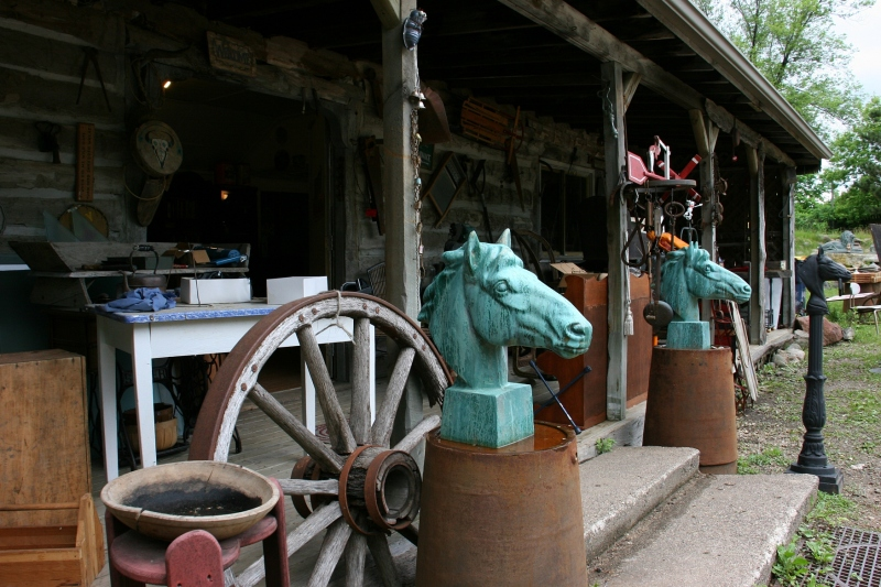 A scene outside a building filled with antiques and collectibles.