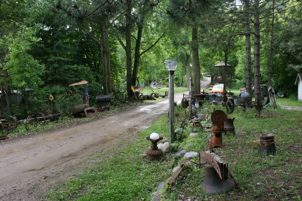 The narrow gravel road into Hot Sam's leads to a quirky world of art and finds.