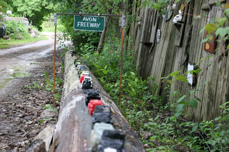 The Avon Freeway is new since my last visit to Hot Sam's several years ago. Avon collectible vehicles line this log along the driveway.