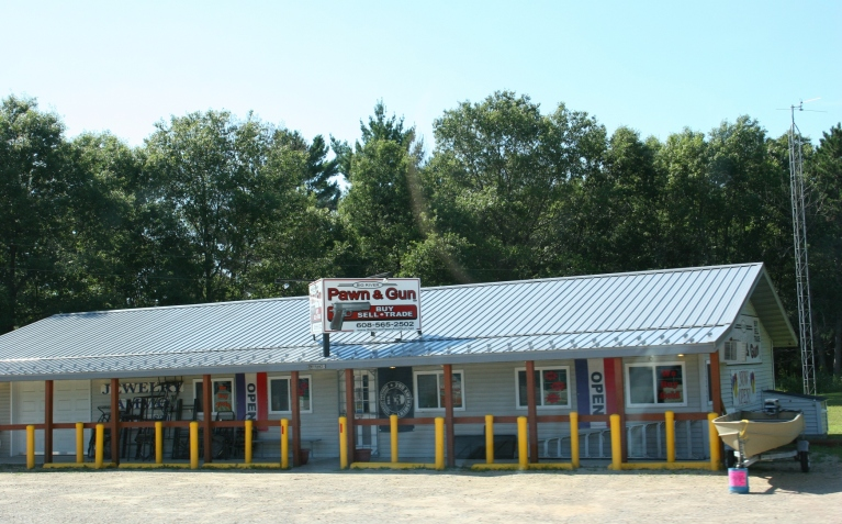 A pawn shop, somewhere along State Highway 21 between Omro and Tomah advertises guns.