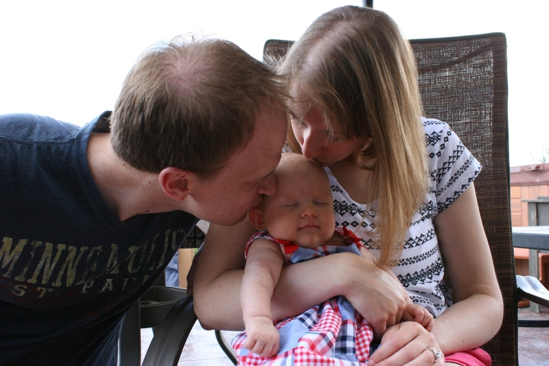 At the exact moment Marc and Amber kissed their daughter, Isabelle closed her eyes in contentment. This photo was not staged; it's a moment of sweet family love I managed to capture.