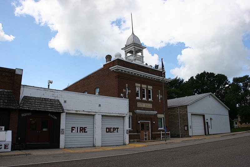 The fire hall and city hall sit next to Nerstrand Meats.