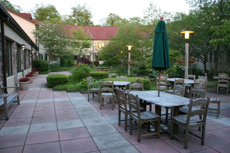 A lovely courtyard filled with plants and with a water feature offers a lovely place to dine outside the Courtyard Cafe.