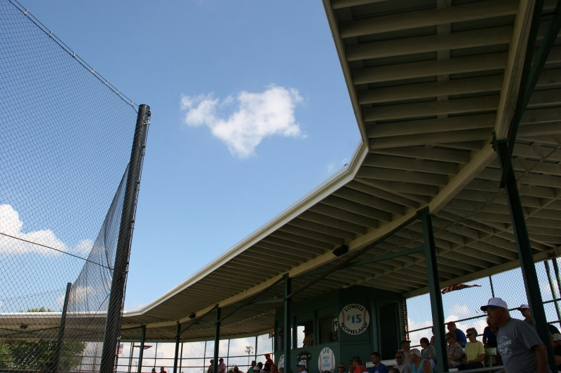 The roofed grandstand keeps fans cool.