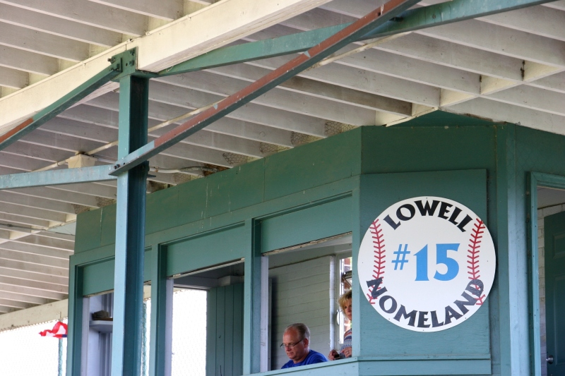 On either side of the announcer's box, I saw barn swallows swoop under the roof.