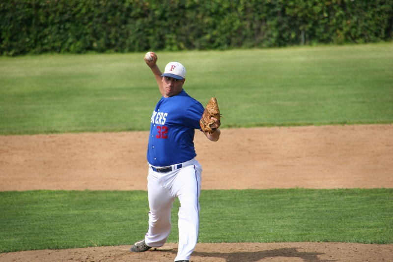 A later shot of Lane also pitching.
