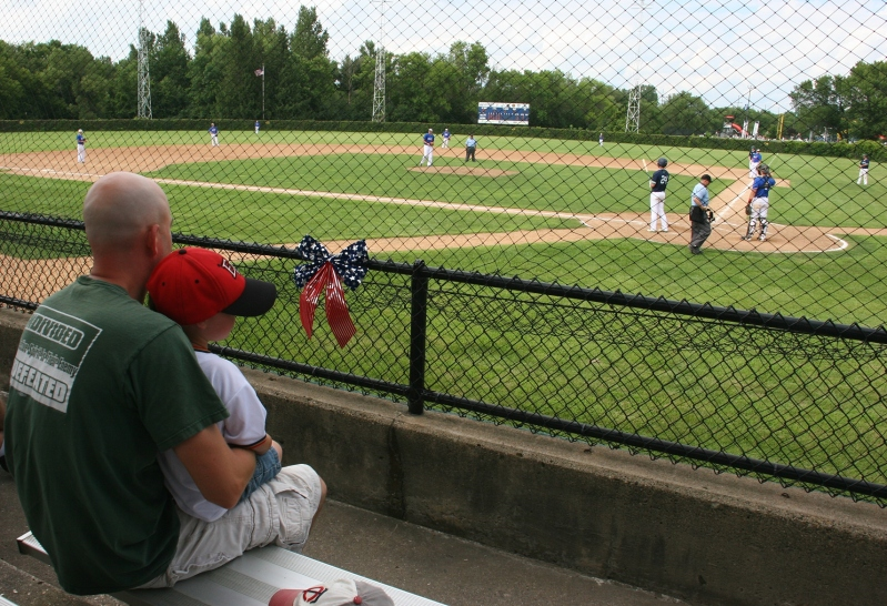 Father and son bond at the ball game.