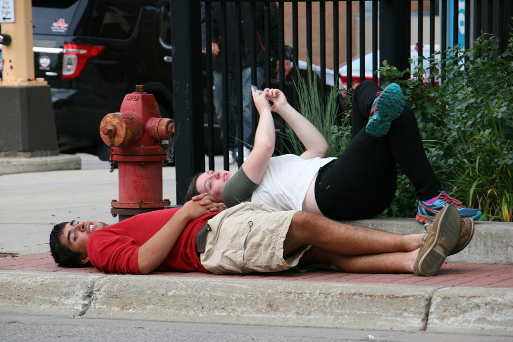 I always people watch. I have no idea why this couple was lying on the sidewalk at the intersection of Central Avenue and Fourth Street.