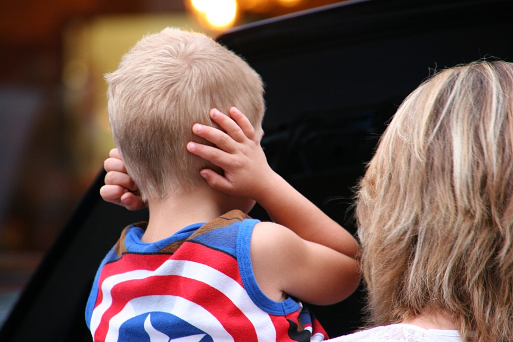 When a particularly noisy souped up car roared down Central Avenue, this boy covered his ears. I did the same.