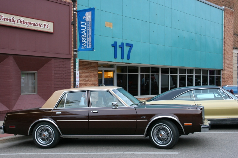 This Chrysler LeBaron doesn't seen all that old to me. That tells me something. I like the plain canvas backdrop of building #117, which has always been a mystery to me.