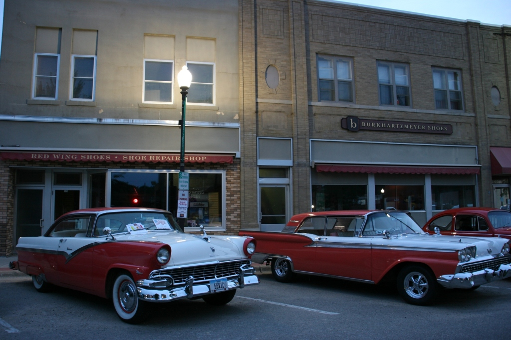 As day faded into darkness, I photographed these Fords parked outside on the Faribault's oldest family-run businesses, Burkhartzmeyer Shoes.