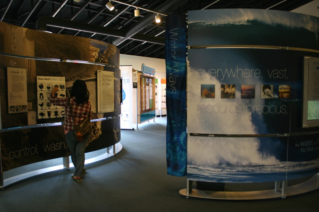 """Entering the """"Water/Ways"""" exhibit, a collection of informational panels."""