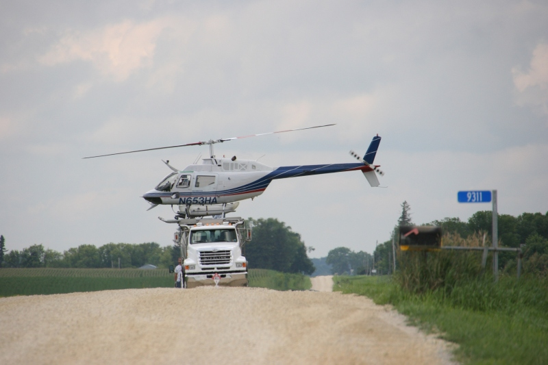 Helicopter spraying, 121 atop truck