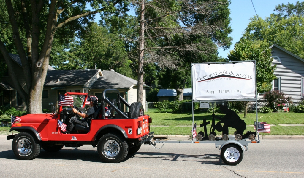 Vietnam Wall Memorial processional, #29 red jeep with wall sign