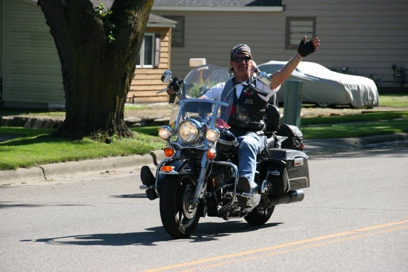 Vietnam Wall Memorial processional, #49 biker waving
