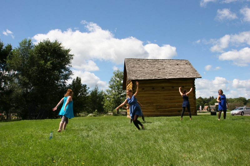 The southern Minnesota based Rural Route Dance Ensemble performs Sunday afternoon next to a log cabin at the History Site Treaty Center along Highway 169 in St. Peter.