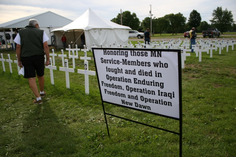Visitors peruse the crosses honoring the most recent war dead from Minnesota.