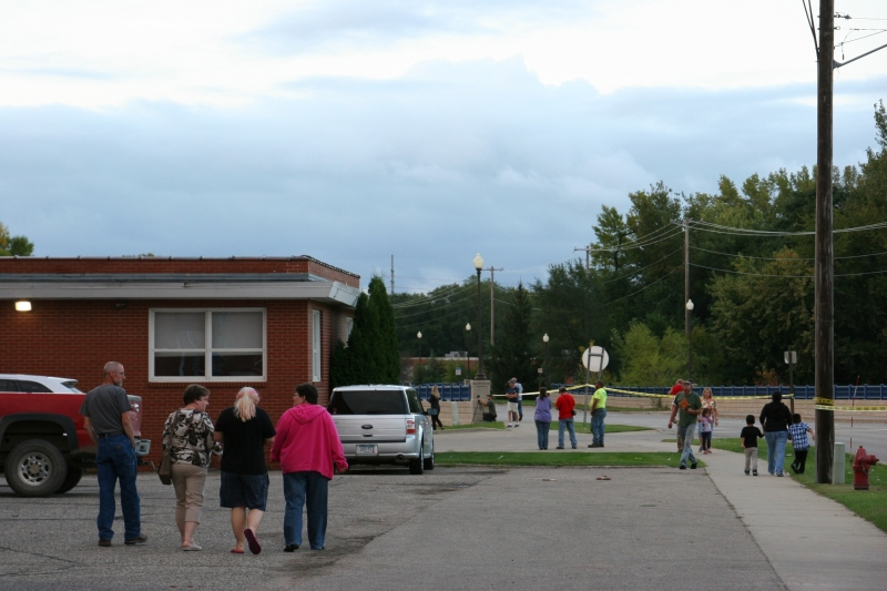 Locals headed across the Faribault Woolen Mill parking lot toward the rising Cannon River.