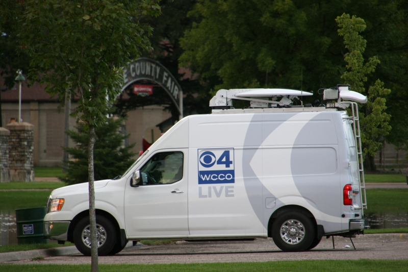 This Twin Cities news crew, parked near the Rice County Fairgrounds entry Thursday evening, was filming at the Faribault Woolen Mill.