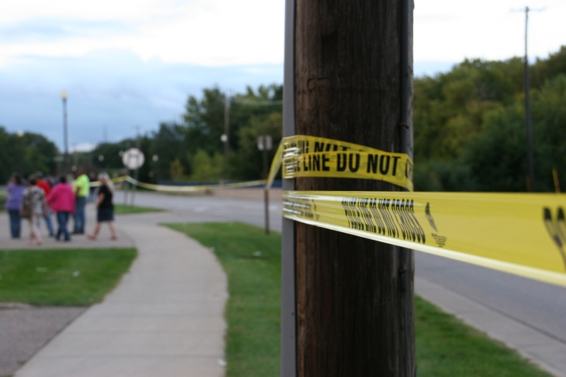 Police tape runs along the sidewalk on Second Avenue between the Faribault Woolen Mill and Faribault Foods.