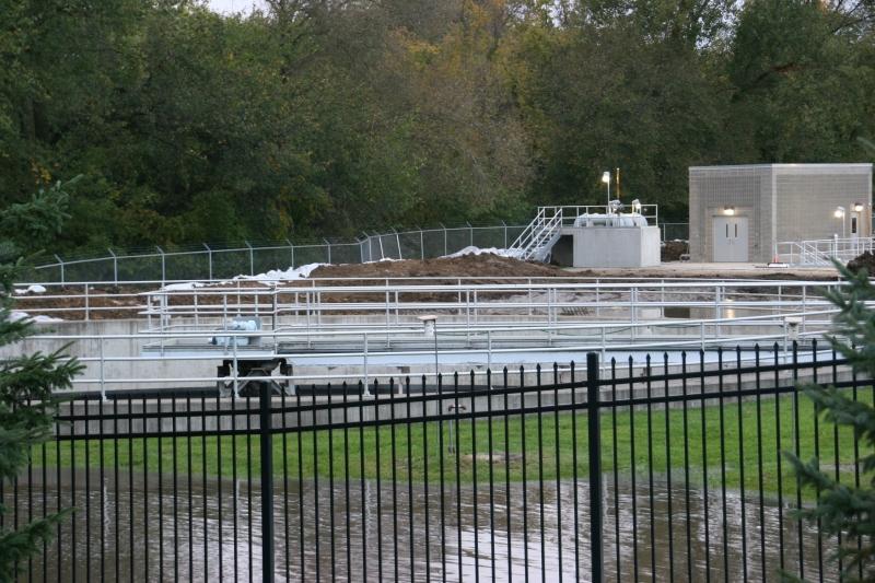 A hastily built berm and sandbags protect the treatment plant.