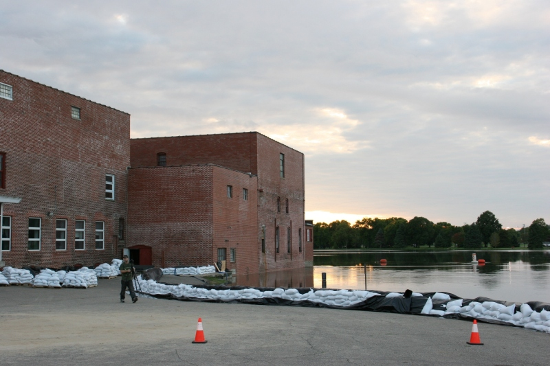 A line of sandbags protect the mill operation and retail store along the banks of the Cannon River.