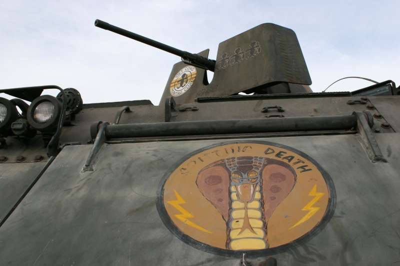 A close-up of a tank on display reveals the harsh words of war.