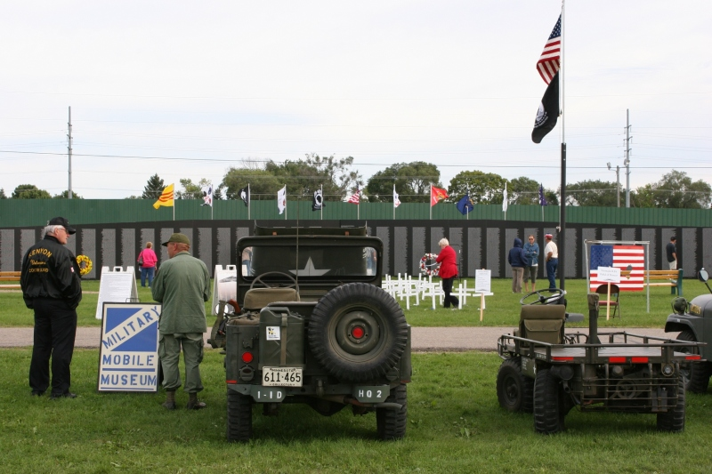 An overview of the Traveling Wall (background) and the military equipment displayed recently at the Rice County Fairgrounds.