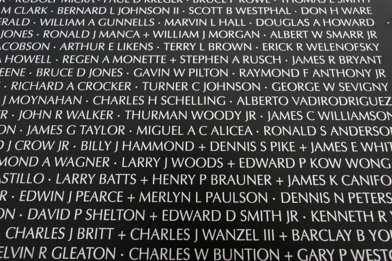 A close-up of names on the Traveling Vietnam Memorial Wall.