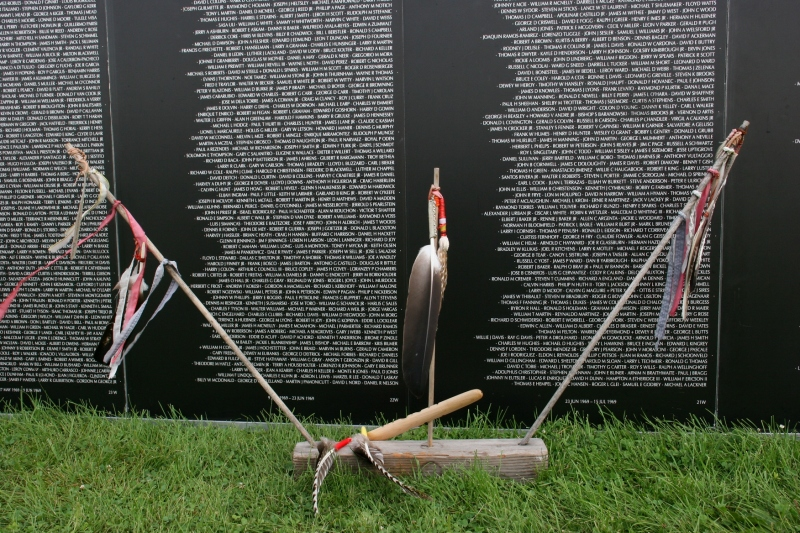 Ceremonial feathers and a peace pipe honor Blair Two Crow.