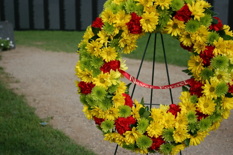 Multiple wreaths featured words of remembrance.
