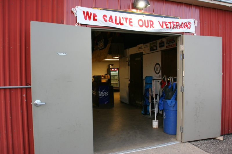 Signage welcomes veterans only to the veterans' lounge.