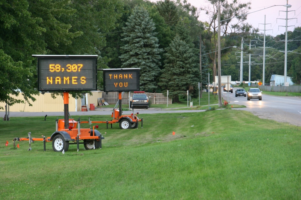 These electronic signs are stationed by the Rice County Highway Department building along Minnesota State Highway 3 across from the fairgrounds. They welcomed Vietnam veterans during Wednesday's processional.