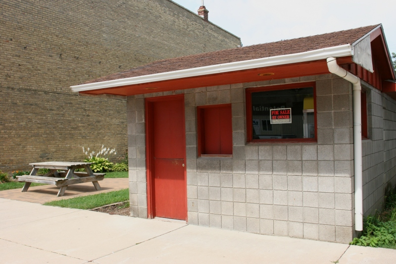 And next to the mini park sits this mini building, which is for sale. I peered inside to see a popcorn machine, making this a former popcorn stand.