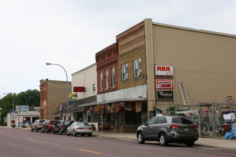A snippet of Waterville's Main Street, including Ron's Hardware, jam-packed with merchandise.