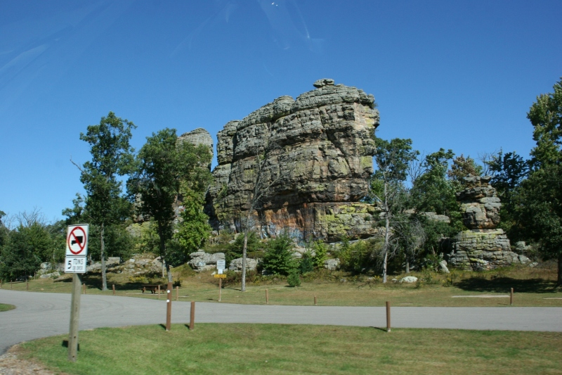 The natural attraction, Castle Rock, juts up from the landscape.