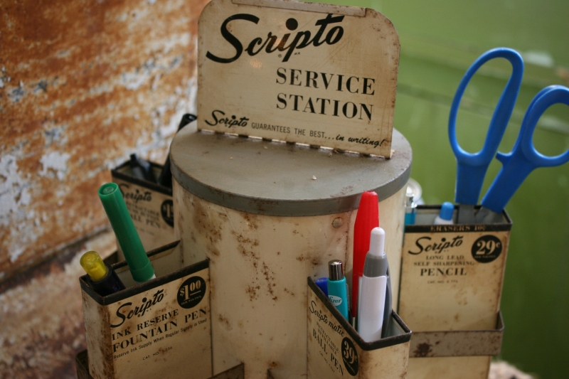 Sitting on the front counter, this Scripto service station is being used and is not for sale.